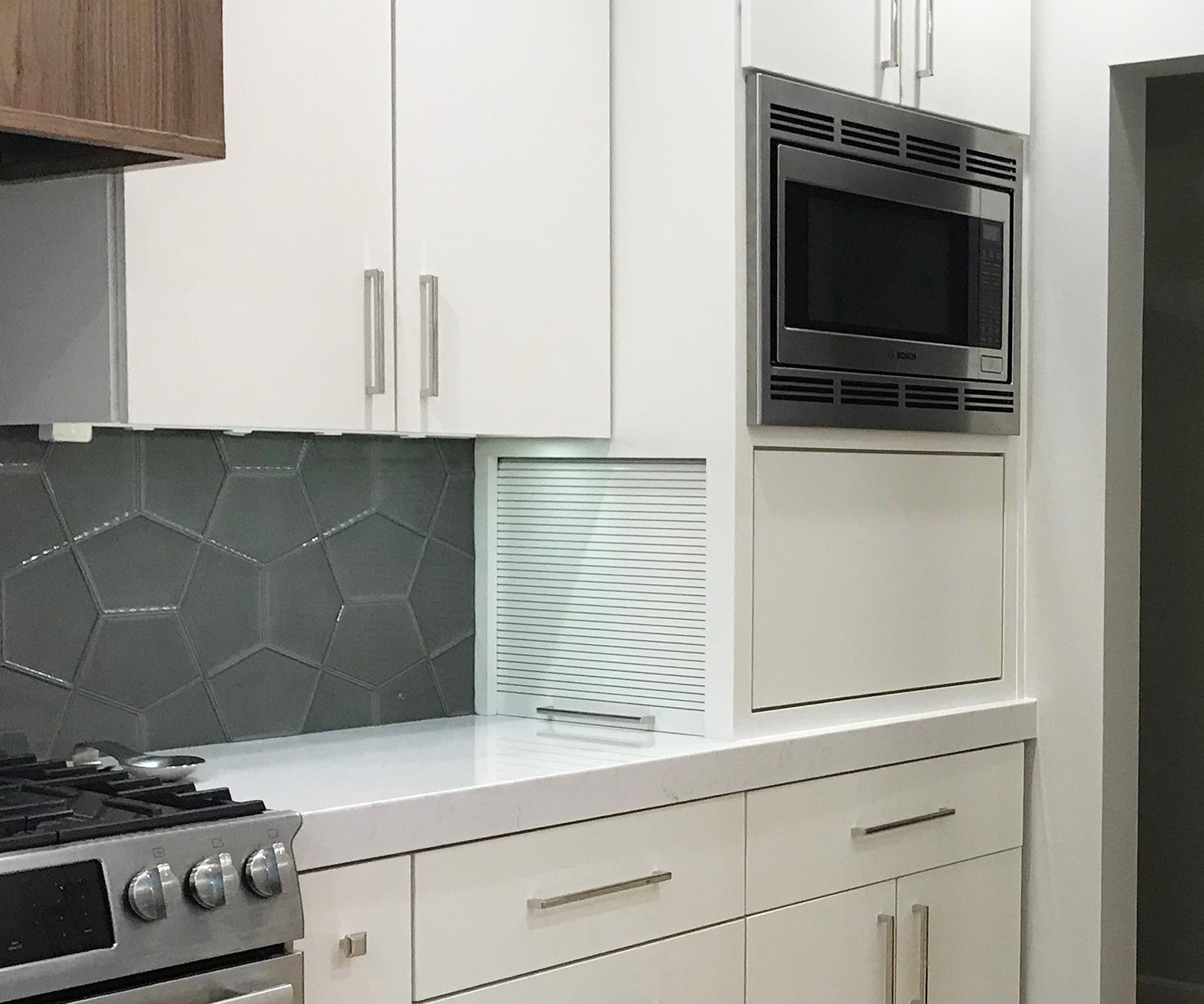 Tambour door for appliance garage
